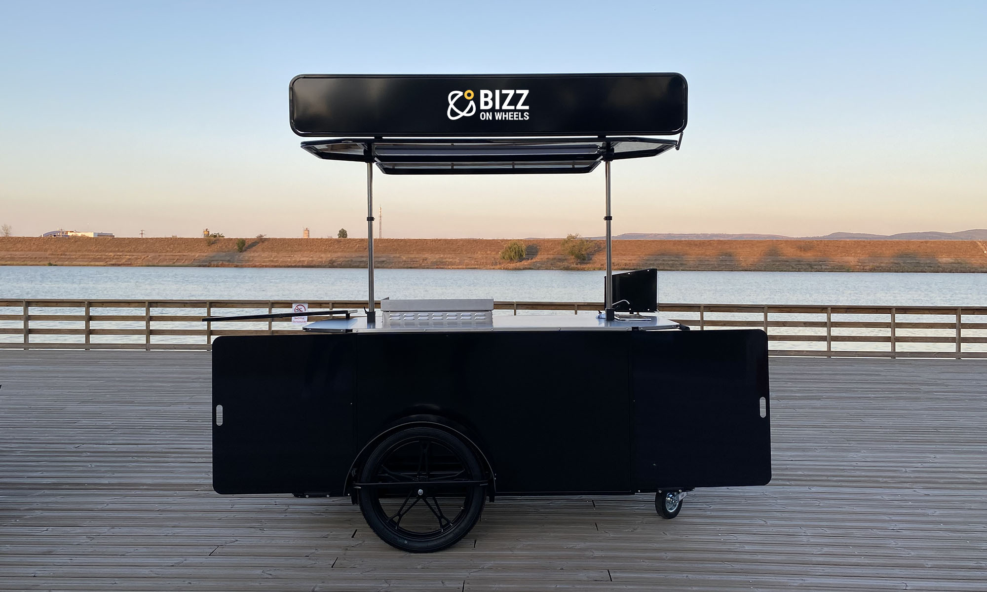 Large bbq grill food cart made by Bizz On Wheels