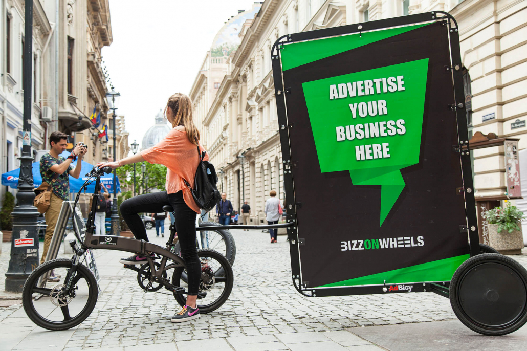 Advertising bike with AdBicy bike trailer