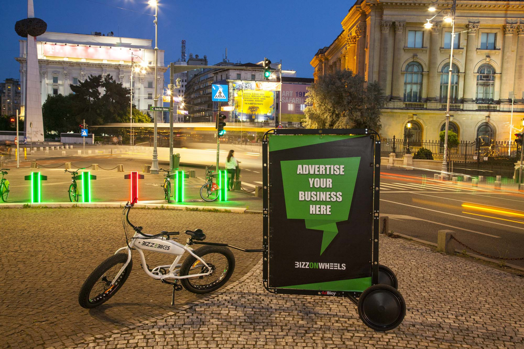 E-bike with AdBicy advertising bike trailer