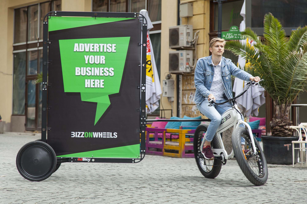 Electric adbike with AdBicy mobile billboard and promoter