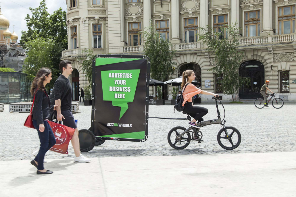 Outdoor advertising with advertising bike and mobile billboard