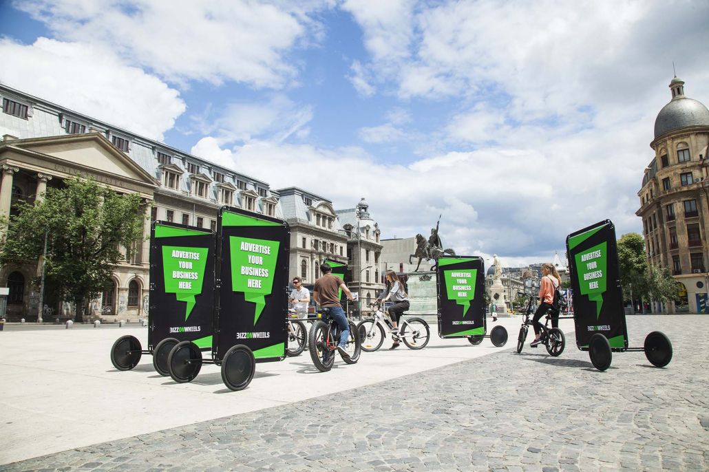 Fleet of advertising bicycles with mobile billboards
