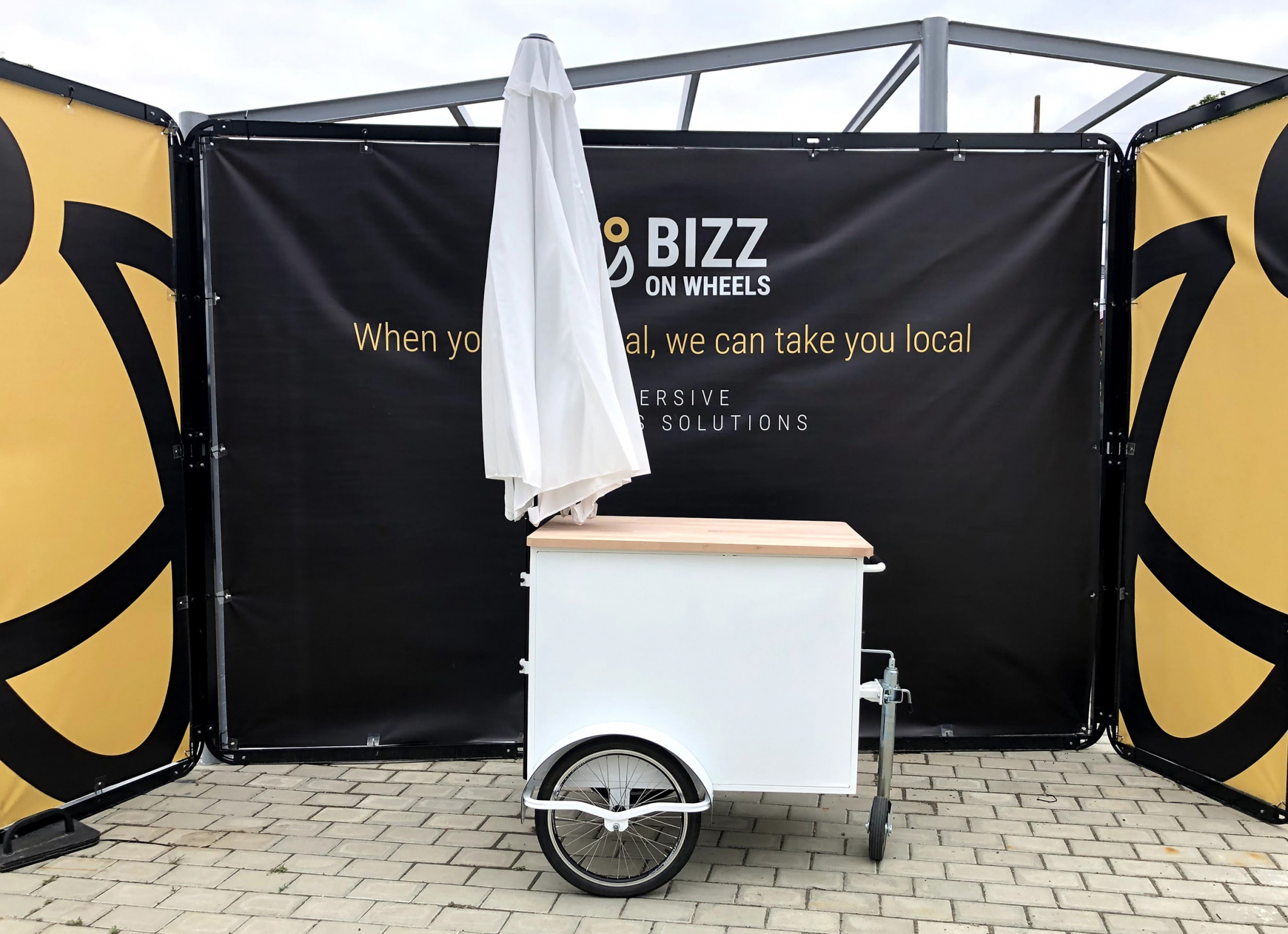 Small white food vending cart by Bizz On Wheels